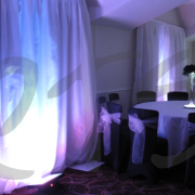 white-drape-backgrouond-with-uplights-l