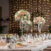 Decorated table in the restaurant, the preparation before the banquet. the work of professional florists.
